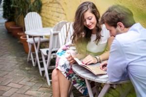 couple-on-date-reading-menu-w724